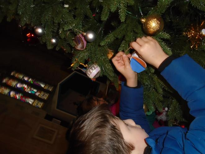 Decorating the tree with our handmade decorations.