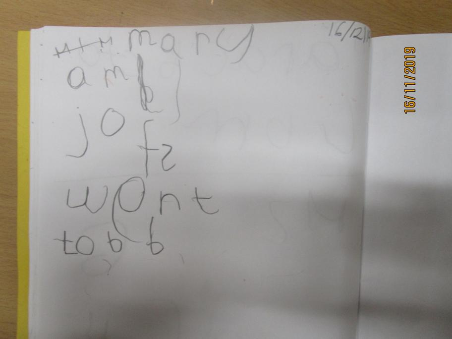 This children has used his phonics to write words.