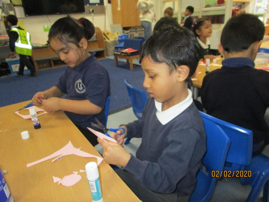 Children made farm animals using card.