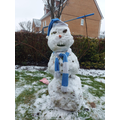 This snowman is keeping warm in his scarf - or is he?