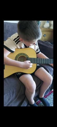 Mikey Practising Guitar