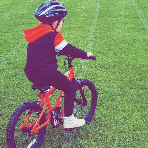 Frankie has learnt to ride his bike.