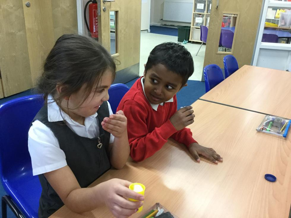 KS1 using their senses to identify different smells (this one was vinegar!)