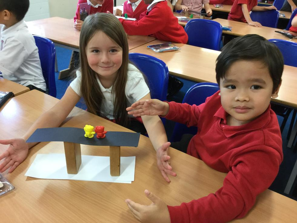 KS1 attempting a STEM challenge - to build the strongest bridge out of paper