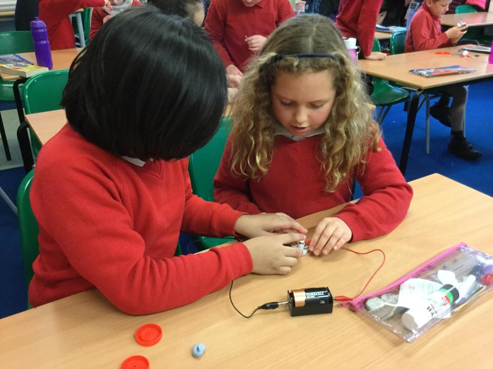 KS2 seeing if they can make a bulb light up