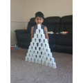 Essa made a tall tower from cups