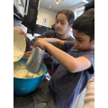 Eesa and Alliyah baking together
