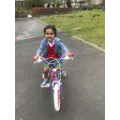 Zaynah has learnt to ride her bike