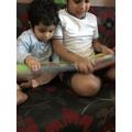 Muhammad Suyfan was reading to his sister
