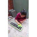 Hajrah is planting seeds for the first time.
