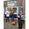 Mr Robertson and Mrs Hill accepting the donations from Morrisons