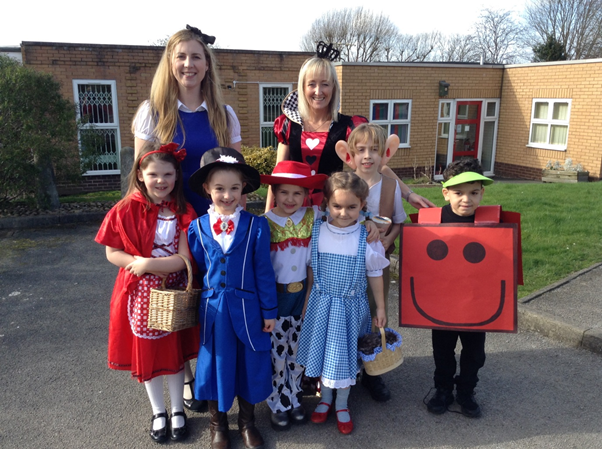 Staff and children dressed as book characters