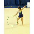 Striking a pose in the rhythmic gymnastics event.