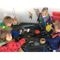 Making mud pies in the Dinosaur Cafe.