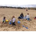 Building sandcastles.