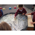 Magic mark making in the glitter tray