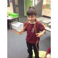 Lucas bravely holds the snake!