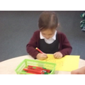 Isobella creating a picture for her mummy...