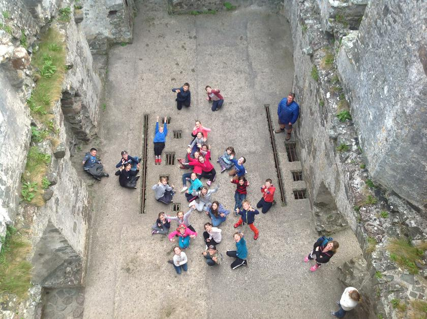 Learning the history of the local castle.