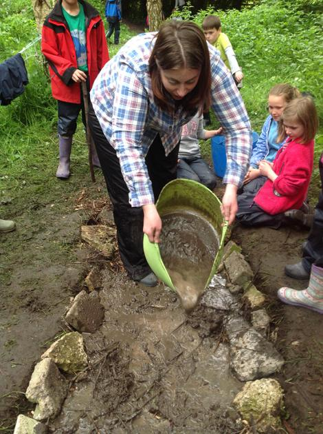 Mrs Jenkins adding the 'cement' to the Roman Road