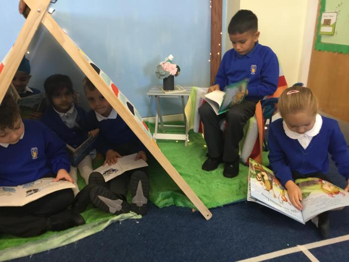Blue 2's reading area has a camping theme.