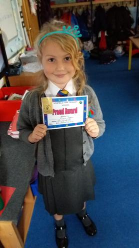 Amelia getting her PROUD certificate