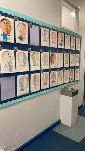 The children's completed 'inside and outside me' portraits and poetry.