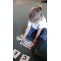 Tilly wrote the cvc word 'duck' independently