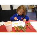 Making hedgehog collages using autumn leaves which we collected.
