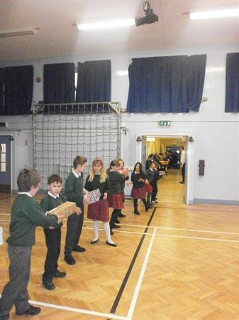 We formed a human chain to transport the boxes!