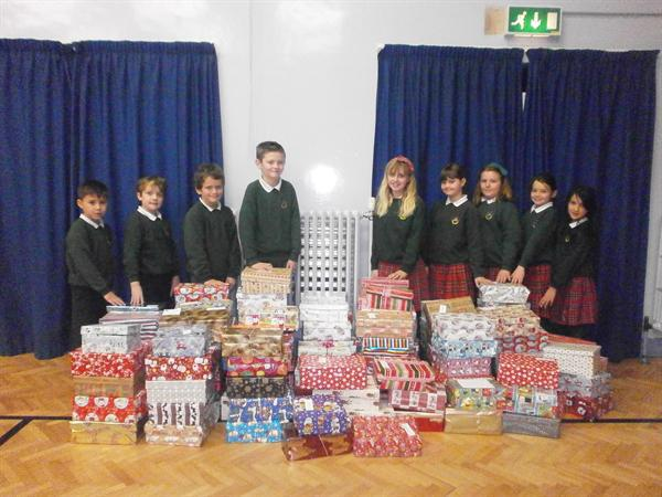 Pupil Council with the shoeboxes we collected
