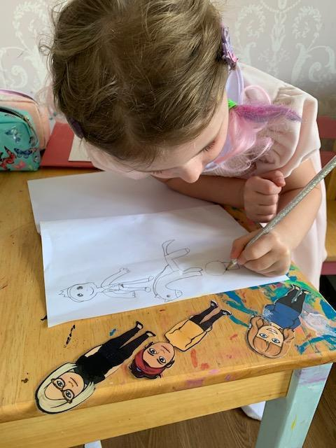 A.Belle writing her own pirate story