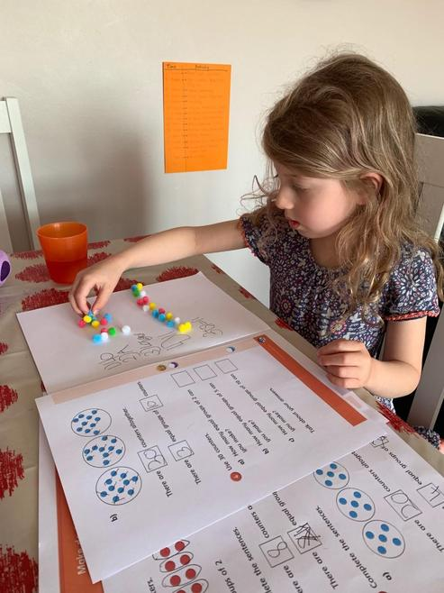 Charlie-Rose using pom poms to support maths