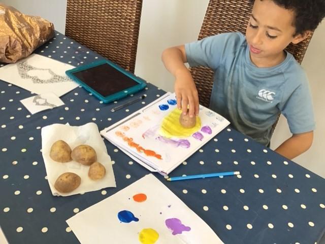 Iestyn creating prints using his veggies