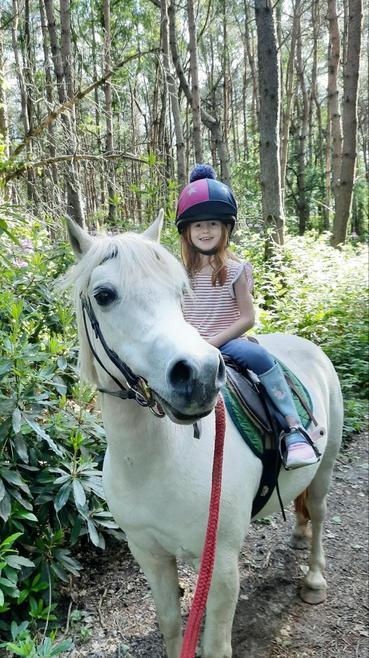Ella riding her horse