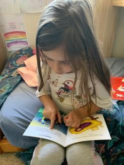 Lilla reading peacefully