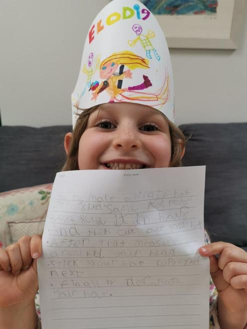 Elodie and her pirate hat with instructions