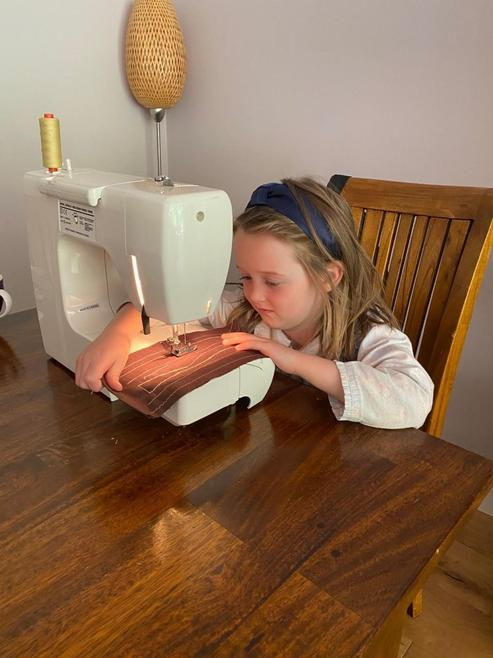 Learning to use a sewing machine!