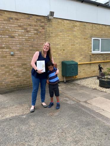 Summer Raffle 1st Prize Winner Daniel in Reception with his mum Helen