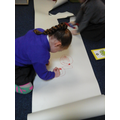 Drawing around different letter shapes.