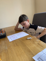 Rhys focussing hard on his maths measurement work
