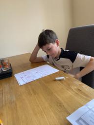 Rhys focussing hard on his maths measurement work