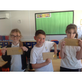 Harry, Daisy and Amelia with their invitations to the prize presentation evening