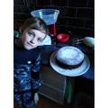 Ben has made a delicious chocolate cake.
