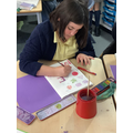 Emily is 'dragging' her colours to change the colour value