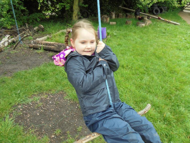 Swinging :) she loved this part of the Forest School
