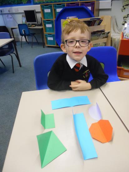 Folding shapes twice to practise quartering