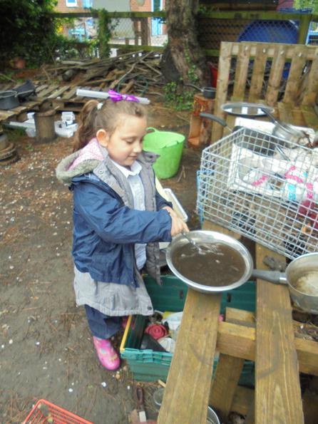 Working hard in the mud kitchen