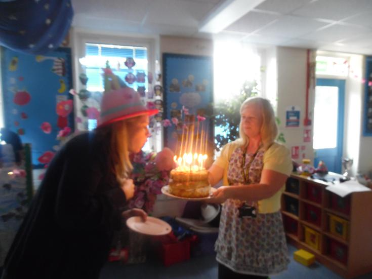 Miss Barrett blowing her candles, make a wish!