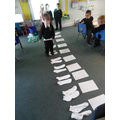 We have used pairs of socks to count in 2's.